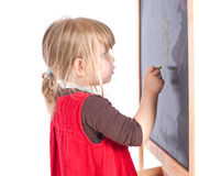 Preschool girl drawing on blackboard Stock Photos
