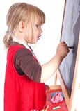 Preschool girl drawing on blackboard Stock Images