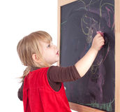 Preschool girl drawing on blackboard Stock Photography