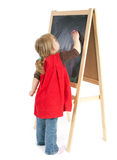 Preschool girl drawing on blackboard Stock Image