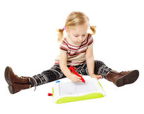 Preschool girl drawing on a board Royalty Free Stock Photos