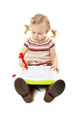 Preschool girl drawing on a board Stock Image