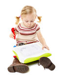 Preschool girl drawing on a board Stock Photos