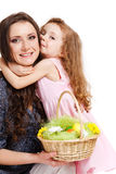 Preschool girl embracing her mom Stock Image