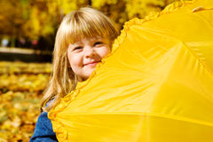 Preschool girl hiding Stock Image