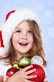 Preschool girl holding Christmas decoration Royalty Free Stock Photo