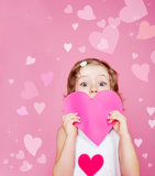 Preschool girl holding paper heart Royalty Free Stock Image