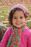 Preschool girl in knits. Beautiful preschool aged girl wearing fashionable autumn clothes Royalty Free Stock Photos