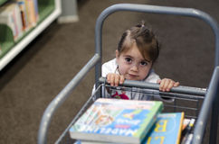 Preschool girl in library Stock Image
