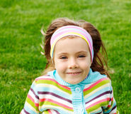 Preschool girl in park Royalty Free Stock Photos