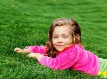 Preschool girl in park Royalty Free Stock Photo