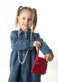 Preschool girl playing dress up Stock Images