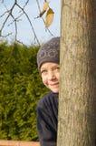 Preschool girl playing hide and seek Stock Photos