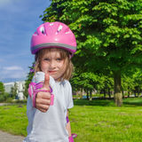 Preschool girl in protective sportwear Stock Photo