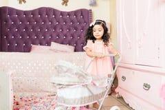 Preschool Girl Pushing Baby Cart At Home royalty free stock photos