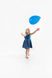 Preschool girl reaches for balloon Royalty Free Stock Images
