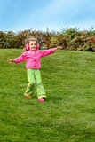 Preschool girl running down the hill Stock Images