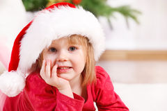Preschool girl in Santa hat Royalty Free Stock Image
