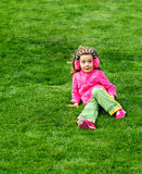 Preschool girl sitting on the hill Royalty Free Stock Photography