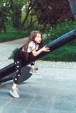 Preschool girl sitting on top of a anchor. Close, view stock photography