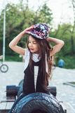 Preschool girl sitting on top of a cannon. Close view stock photography