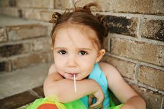 Preschool girl with tutu and sucker Stock Image