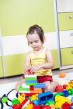 Preschool girl who build towers with cubes at kind Royalty Free Stock Photos