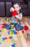 Preschool girl who build towers with cubes Stock Image