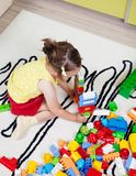 Preschool girl who build towers with plastic cubes Royalty Free Stock Images