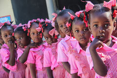 Preschool girls and boys in rural Robillard, Haiti. Preschool girls and boys line up before class in rural Robillard, Haiti stock image