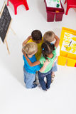 Preschool huddle Royalty Free Stock Photos