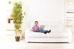 Preschool kid with laptop at home Royalty Free Stock Photo