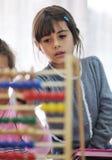 Preschool kids. Happy child kids group have fun and play at kindergarden indoor preschool education concept with teacher stock photo