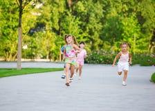 Preschool kids race. In a summer park Royalty Free Stock Photos