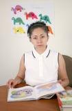 Preschool or kindergarten teacher. A pretty hispanic preschool or kindergarten teacher royalty free stock photos