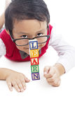 Preschool student showing blocks Learn. A Preschooler showing block of toys with the word LEARN Royalty Free Stock Photography