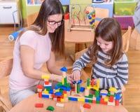 Preschool Teacher and Kid Building Castle Royalty Free Stock Photos