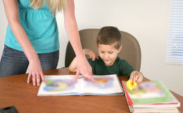 Preschool teacher and student Royalty Free Stock Photos