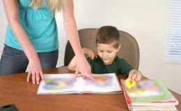 Preschool teacher and student royalty free stock photos
