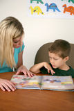 Preschool teacher and student stock image