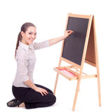 Preschool teacher woman writing on blackboard Stock Images
