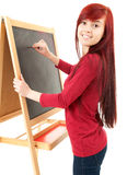 Preschool teacher woman writing on blackboard Stock Photos