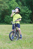 Preschooler and bike. 6 years old boy with bike and bottle of water royalty free stock images