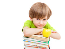 Preschooler with books and apple. Isolated against white background Stock Photo