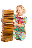 Preschooler with books stack Stock Images
