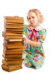 Preschooler with books stack. Preschooler sitting beside old books stack stock images