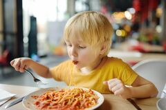Free Preschooler Boy Eating Pasta With Tomatoes In Cafe Or Restaurant. Healthy/unhealthy Food For Little Kids Royalty Free Stock Photos - 189044708