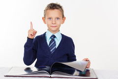 Preschooler boy with finger up Royalty Free Stock Photos