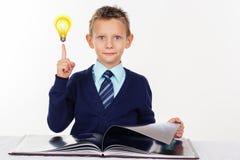 Preschooler boy with finger up, inspiration Stock Images