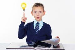 Preschooler boy with finger up, inspiration Stock Image